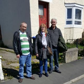 Tommy Chalmers (left), Pat McBain (centre) and Robert Weston (right) outside the house in Turriff where their father lived