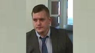 CCTV image of man in bank
