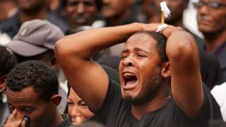 A mourner screams for a loved one who perished in the Ethiopian Airways ET302 during a memorial service at Selassie Church on March 17, 2019 in Addis Ababa, Ethiopia.