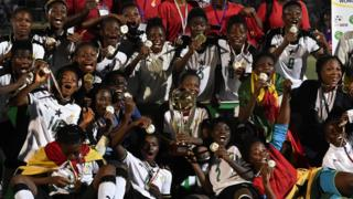"""Ghana team players celebrate with trophy after winning the first West African Football Union (UFOA) zone B women""""s tournament final match between Ghana and Ivory Coast at the Parcs des Sports in Abidjan on February 24, 2018"""