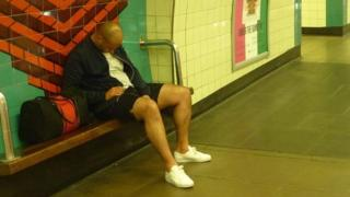 man sleeping on platform