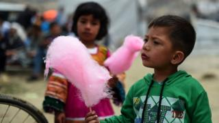 Afghan children enjoy candy floss during last year's Nowruz festival in Kabul