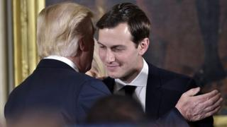 Donald Trump (l) talking to son-in-law Jared Kushner