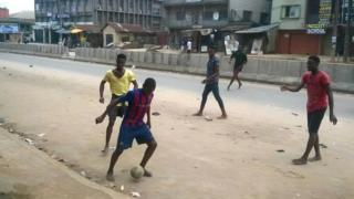 The children playing football on a street in Ariaria in Abia state