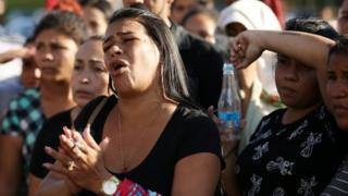Relatives of inmates react in front of a prison complex in the Brazilian state of Amazonas after prisoners were found strangled to death in four separate jails, according to the penitentiary department in Manaus, Brazil May 27, 2019