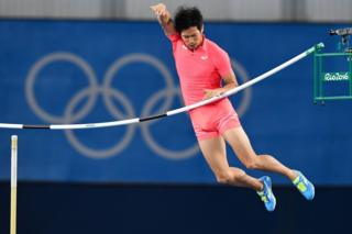 Japan's Hiroki Ogita knocks the pole vault bar off in the Men's Pole Vault Qualifying Round in Rio de Janeiro on 13 August 2016.