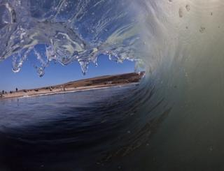 A shore break captured from within the wave