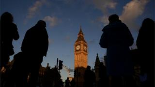 Silhouettes outside Parliament