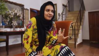 Khadeeja Siddiqui, 23, a Pakistani law student who was stabbed 23 times by a classmate after she had rejected him romantically, speaks during an interview with AFP in Lahore