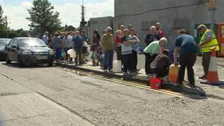 People queue to collect water in County Louth