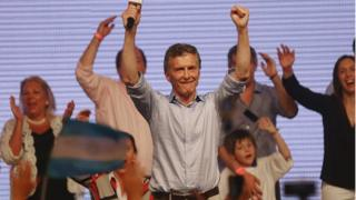 Opposition presidential candidate Mauricio Macri celebrates after defeating ruling party candidate Daniel Scioli