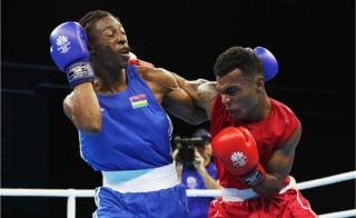 Jone Davule of Fiji and Louis Richarno Collin of Maritius compete in boxing