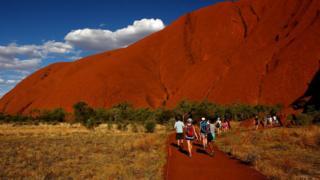 Tourist visiting Uluru in 2013