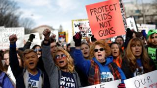"""Demonstrators chant as students and gun control advocates hold the """"March for Our Lives"""" event demanding gun control after recent school shootings at a rally in Washington"""