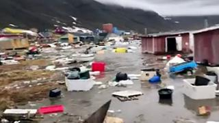 Houses close to Nuugaatsiag, Greenland, flooded by tidal waves on 18 June, 2017.