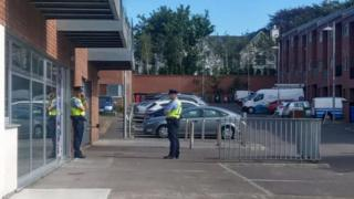 Gardaí standing outside the apartments in the Elderwood complex where the girl was found