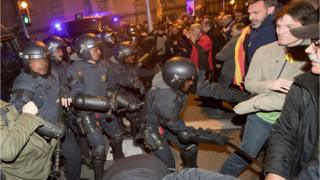 Catalonian riot police clash with protesters at the headquarters of the Spanish Government Delegation in Barcelona, 23 March 2018