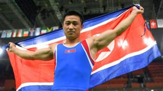 Ri Se-gwang, holding the North Korean flag, winning gold for North Korea in the vault at the 2016 Rio Olympics