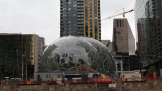 Online retail powerhouse Amazon is constructing an eye-catching Spheres office building to feature waterfalls, tropical gardens and other links to nature as part of its urban campus on May 11, 2017 in downtown Seattle, Washington.