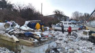 The clean-up operation at the marina in Holyhead