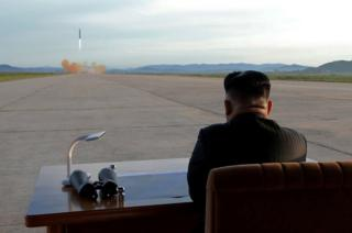 North Korean leader Kim Jong Un watches the launch of a Hwasong-12 missile.