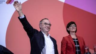 Norbert Walter-Borjans and Saskia Esken celebrate winning the SPD race