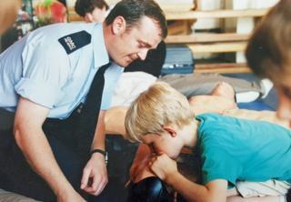 Phil Murphy teaching school children CPR