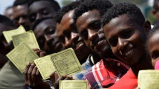 in_pictures Voters pose with their identity documents during the Sidama referendum in Hawassa, Ethiopia - Wednesday 20 November 2019