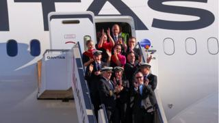 Qantas Group CEO Alan Joyce and his crew after arriving at Sydney Airport after performing a continuous test flight from New York