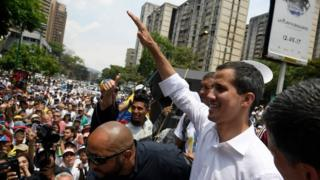 Juan Guaidó gestures to his supporters at a rally in Caracas. Photo: 1 May 2019