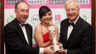 BBC Evening Extra presenter Seamus McKee picks up News Broadcaster of the Year award with producer Claire Noble