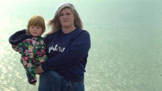 Hana holding her daughter Tilly