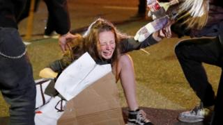 Tear gas was used to disperse crowds protesting in Oakland in California