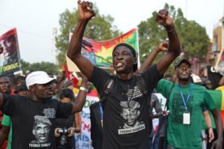 A man raises his arms as he attends a protest in tribute to Thomas Sankara in Ouagadougou, Burkina Faso - Sunday 2 October 2016
