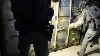Police entering one of the containers