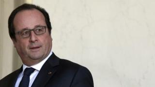 French President Francois Hollande walks to his office at the Elysee Palace in Paris