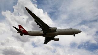 A Qantas aeroplane comes in to land at Melbourne Tullamarine Airport