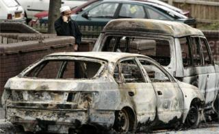 A local man is seen near burnt out vehicles in Lozells area on October 23, 2005 in Birmingham
