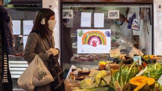 Shopper wears face mask in Italy