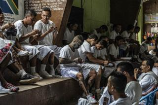 "Inmates in the ""Yo Cambio"" (I Change) Program relax while others knit. Apanteos Penal Institute, El Salvador. 5 November 2018."