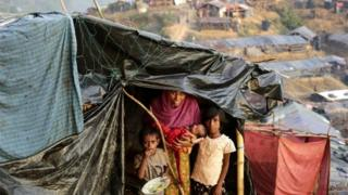 A Rohingya woman poses for a photograph with her children including a new born at her makeshift tent in a camp at Palongkhali, Ukhiya, Coxsbazar, Bangladesh, 05 October 2017.