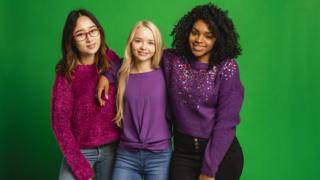 girls-wearing-purple-clothes.