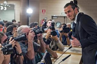 Real Madrid's Welsh midfielder Gareth Bale poses during a press conference in Madrid