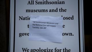 A sign outside the Smithsonian American History Museum lets visitors know when it will be open again while the US government prepares for a temporary three-week reopening on the National Mall January 27, 2019 in Washington, DC.