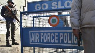 Indian security forces stand guard at an air force base near the Pakistani border