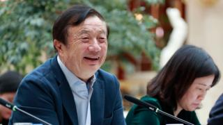 Huawei founder Ren Zhengfei (L) speaking to Chinese media in Shenzhen
