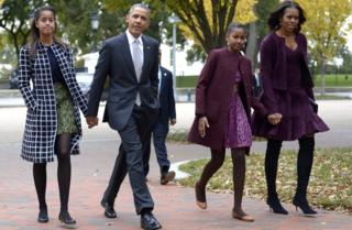 US President Barack Obama walks with his wife Michelle Obama (R) and two daughters Malia Obama (L) and Sasha Obama (2R) through Lafayette Park to St John's Church to attend service October 27, 2013 in Washington, DC.