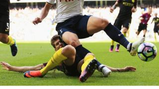 John Stones launches a crunching tackle