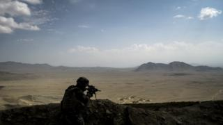 A French soldier secures a perimeter on September 26, 2012, on a forward observing post near the National Police Training Center (NPTC) in Wardak province