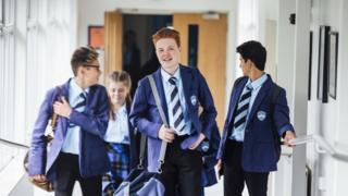 Teenagers in school uniform